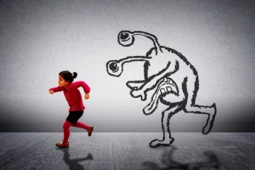 Little cute child running away from a funny monster - Child fears and insecurities concept